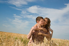 Loving couple on wheat field Royalty Free Stock Image