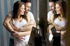 Loving couple by the window Royalty Free Stock Photos