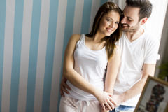 Loving couple by the window Stock Image