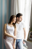 Loving couple by the window Royalty Free Stock Images