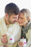 Loving couple in winter clothing with coffee cups Stock Image