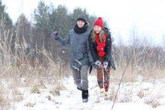 Loving couple in winter forest Stock Image