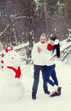 Loving couple in the winter forest Stock Image
