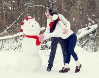 Loving couple in the winter forest Stock Images