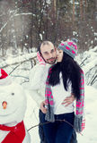 Loving couple in the winter forest Stock Photo