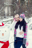 Loving couple in the winter forest Stock Photography