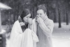 A loving couple on a winter walk. Man and woman on a date in the Royalty Free Stock Photography