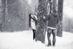 A loving couple on a winter walk. Man and woman on a date in the Stock Images