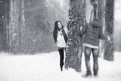 A loving couple on a winter walk. Man and woman on a date in the Stock Photo