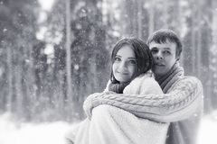 A loving couple on a winter walk. Man and woman on a date in the Royalty Free Stock Photo