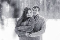 A loving couple on a winter walk. Man and woman on a date in the Royalty Free Stock Image