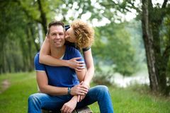 Loving couple with woman kissing man Royalty Free Stock Images