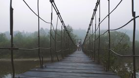Loving Couple on a Wooden Bridge in the Mountains. Morning fog. Slow motion stock video