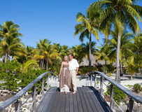 Loving couple on the wooden bridge on the tropical island Royalty Free Stock Photos