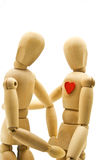 Loving couple of wooden dummies Royalty Free Stock Images