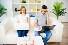 Loving couple working at home Royalty Free Stock Photo
