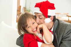 Loving dad kissing daughter in Christmas Royalty Free Stock Photo
