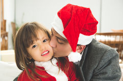 Loving dad kissing daughter in Christmas Stock Photography
