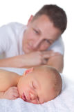 Loving dad with newborn baby. Out of focus father admiring his sleeping newborn baby of 16 days old Stock Images