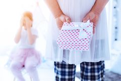 Loving daddy hiding gift prepared for his daughter stock images