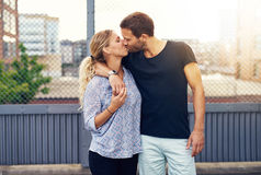 Loving demonstrative man kissing his girlfriend Royalty Free Stock Photography