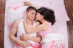 Loving each other couple sleeping in bed Royalty Free Stock Photo