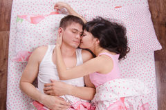 Loving each other couple sleeping in bed Royalty Free Stock Image
