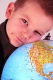 Loving the earth. Boy is loving the whole earth Royalty Free Stock Photography