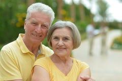 Loving elder couple. Loving smiling elder couple at tropic resort Stock Photography