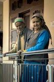 Loving elderly couple standing outside house hand holding railing at Saharan town, Himachal Pradesh. Stock Images