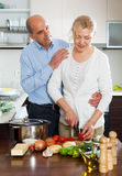 Loving elderly senior and mature woman cooking vegetables Stock Images