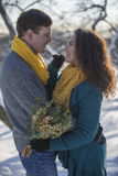 Loving elegant young couple in winter clothing Stock Images
