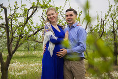 Loving embrace of pregnancy couple Stock Photography