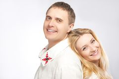 Loving Embraced Caucasian Couple in National Decorated Costumes. Stock Photo