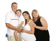 Loving Extended Family. Beautiful family with father, pregnant mother, little boy, and grandmother.  Isolated on white Stock Photos