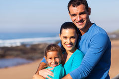 Loving family beach. Loving young family portrait at the beach stock photos