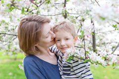 Loving family. Beautiful mother and her little son hugging together at spring time stock image