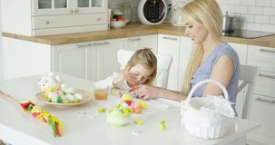Loving family coloring Easter eggs stock footage