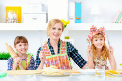 Mother cooks with daughters. Loving family concept. Happy mother cooks with her daughters Royalty Free Stock Photo