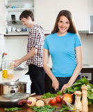 Loving family cooking in kitchen Stock Photography