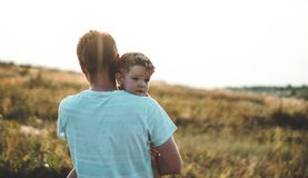 Loving family. Father and his son baby boy playing and hugging outdoors. Happy dad and son outdoors. Concept of Father`s day. Happy loving family. Father and royalty free stock photography