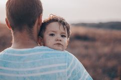 Loving family. Father and his son baby boy playing and hugging outdoors. Happy dad and son outdoors. Concept of Father`s day. Happy loving family. Father and royalty free stock photo