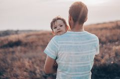 Loving family. Father and his son baby boy playing and hugging outdoors. Happy dad and son outdoors. Concept of Father`s day. Happy loving family. Father and royalty free stock photos