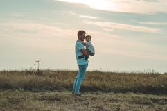 Loving family. Father and his son baby boy playing and hugging outdoors. Happy dad and son outdoors. Concept of Father`s day. Loving family. Father and his son royalty free stock photography