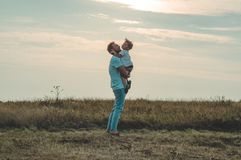 Loving family. Father and his son baby boy playing and hugging outdoors. Happy dad and son outdoors. Concept of Father`s day. Loving family. Father and his son royalty free stock photo