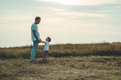 Loving family. Father and his son baby boy playing and hugging outdoors. Happy dad and son outdoors. Concept of Father`s day. Loving family. Father and his son stock photo