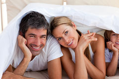 Loving family having fun with on bed Royalty Free Stock Images