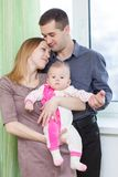 Loving family are holding ther baby Royalty Free Stock Photos