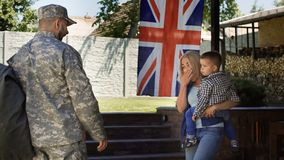 Loving family meeting soldier back at home stock image