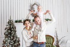Loving family Merry Christmas and Happy New Year. Cheerful pretty people. Mom, dad and little daughter . Parents and. Loving family Merry Christmas and Happy New royalty free stock image